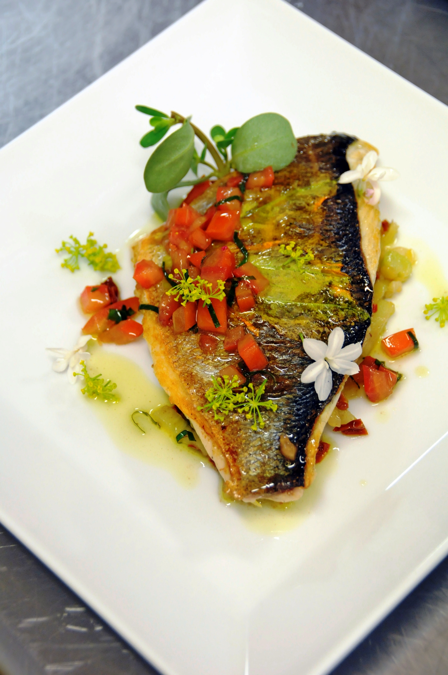 Sea Bream with Fennel, Dried Tomatoes and  Garden Flower Virgin Sauce picture