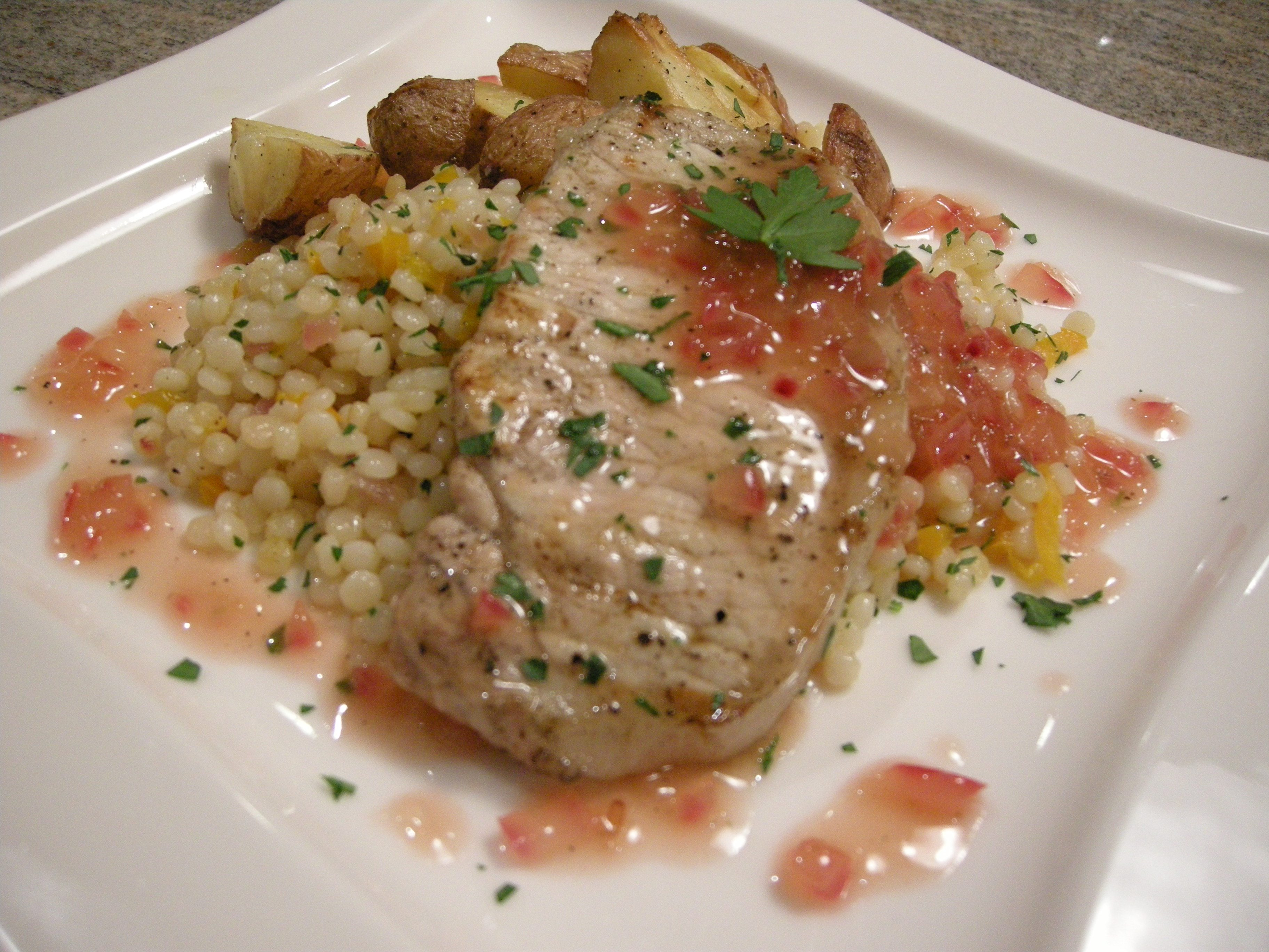 Grilled Pork Chops w/Tokaji Wine Reduction Sauce, Couscous Salad & Roasted Potatoes picture