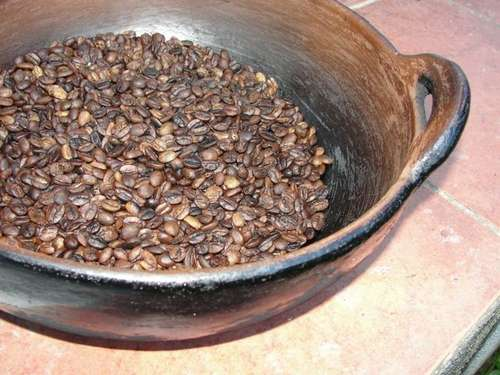 Coffee beans roasting on a pan