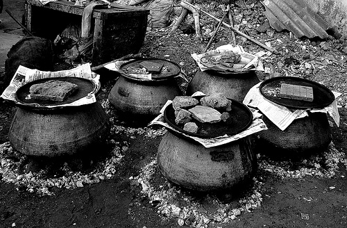 Dampukht cooking in progress - closed vessels cooking meat and rice