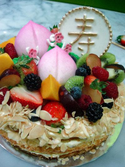 Longevity Buns used to decorate a fruit cake.