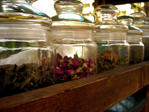 Dried herbs stored in pretty glass jars