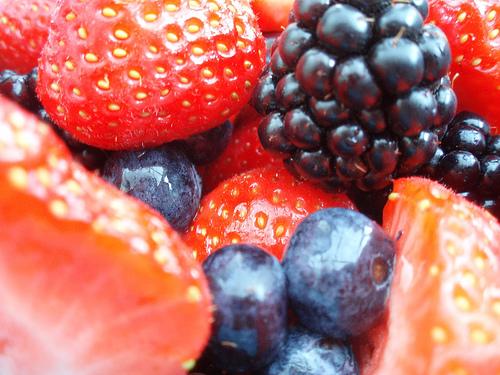 strawberries, blackberries and blueberries