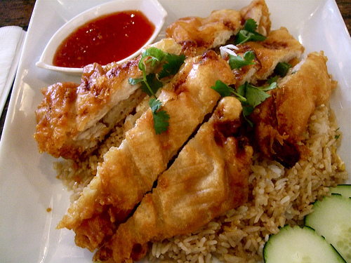 Khao Phat Kai topped with fried chicken