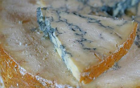 blue veins on a slice of stilton cheese