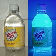 The Canada Dry brand of tonic water, shown on the right under ultraviolet light.