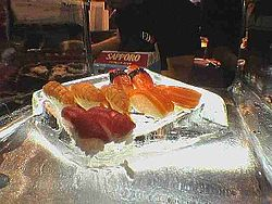 Various nigiri sushi in an ice sculpture