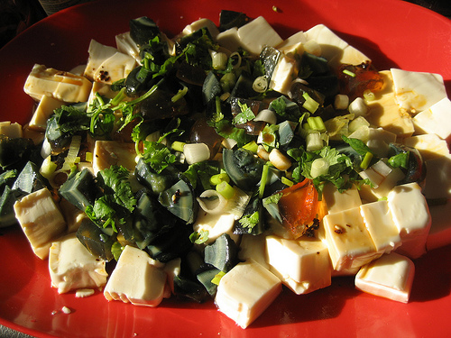 Chilled Tofu, topped with Century Egg chunks and chopped spring onion.