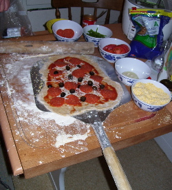 How a pizza peel is useful in preventing the dough from sticking on to any surface.