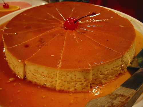 Flan can have different toppings - cherry acts as a center topping