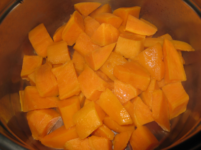 Sweet potato cubes being steamed