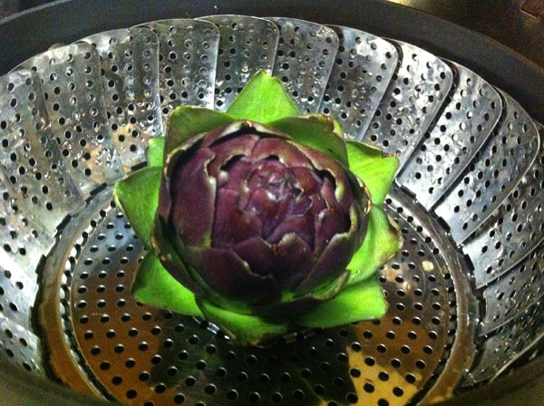 Cook artichoke whole