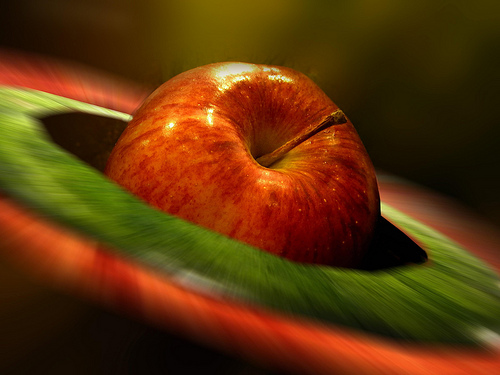 A tempting shiny apple - You still need to clean the wax of the apple before having it.