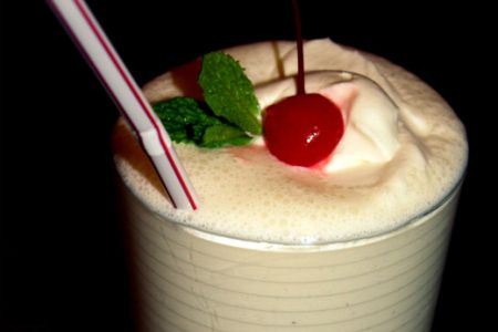 Vanilla milkshake with cherry topping