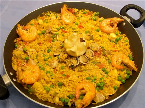 Valencian paella is eaten with fish, vegetables and meat