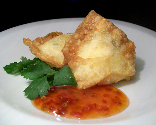 Crab Rangoons are crab meat and cream cheese filled wontons.