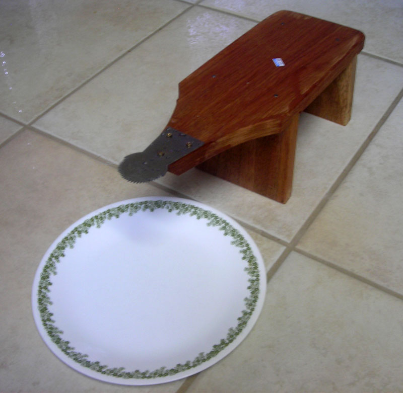 The traditional coconut scraper used by my granny.