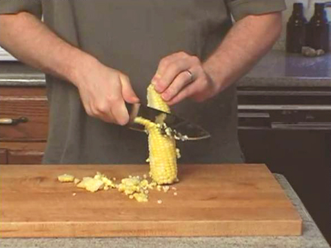 Though many gadgets are available to cut sweet corn off the cob, doing it with a sharp knife is quite easy too