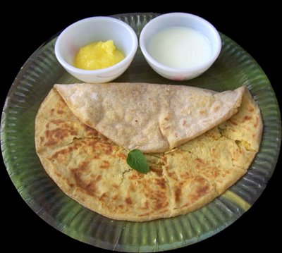 Puran poli is traditionally eaten with milk and ghee