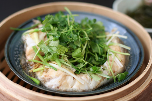 Steaming cod in a basket