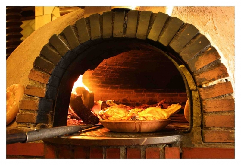 Use of wood burning oven and clay vessel to roast the meat gives Lechazo Asado the enchanting earthy flavors