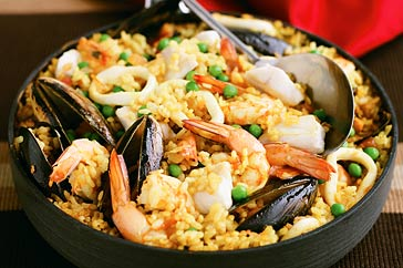 Seafood paella is a wonderful combination of a variety of seafood