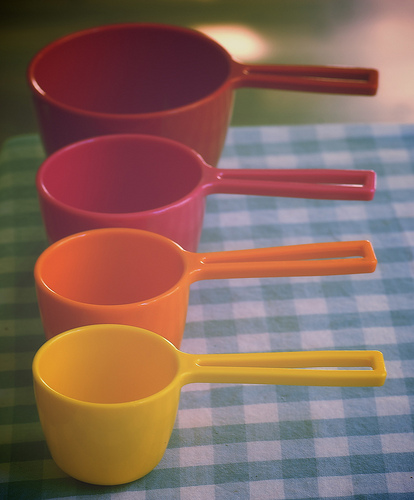 Plastic measuring cups can be used to measure dry ingredients.