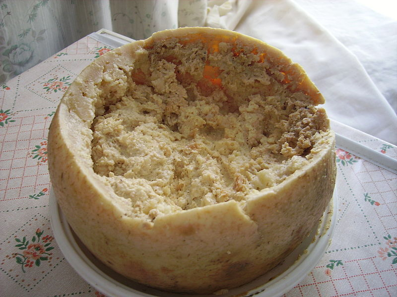 Casu marzu is a runny white cheese made by injecting Pecorino Sardo cheese with cheese-eating larvae that measure about one-half inch long.