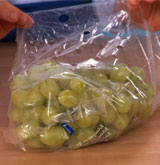 Storing grapes in plastic bag in the freezer