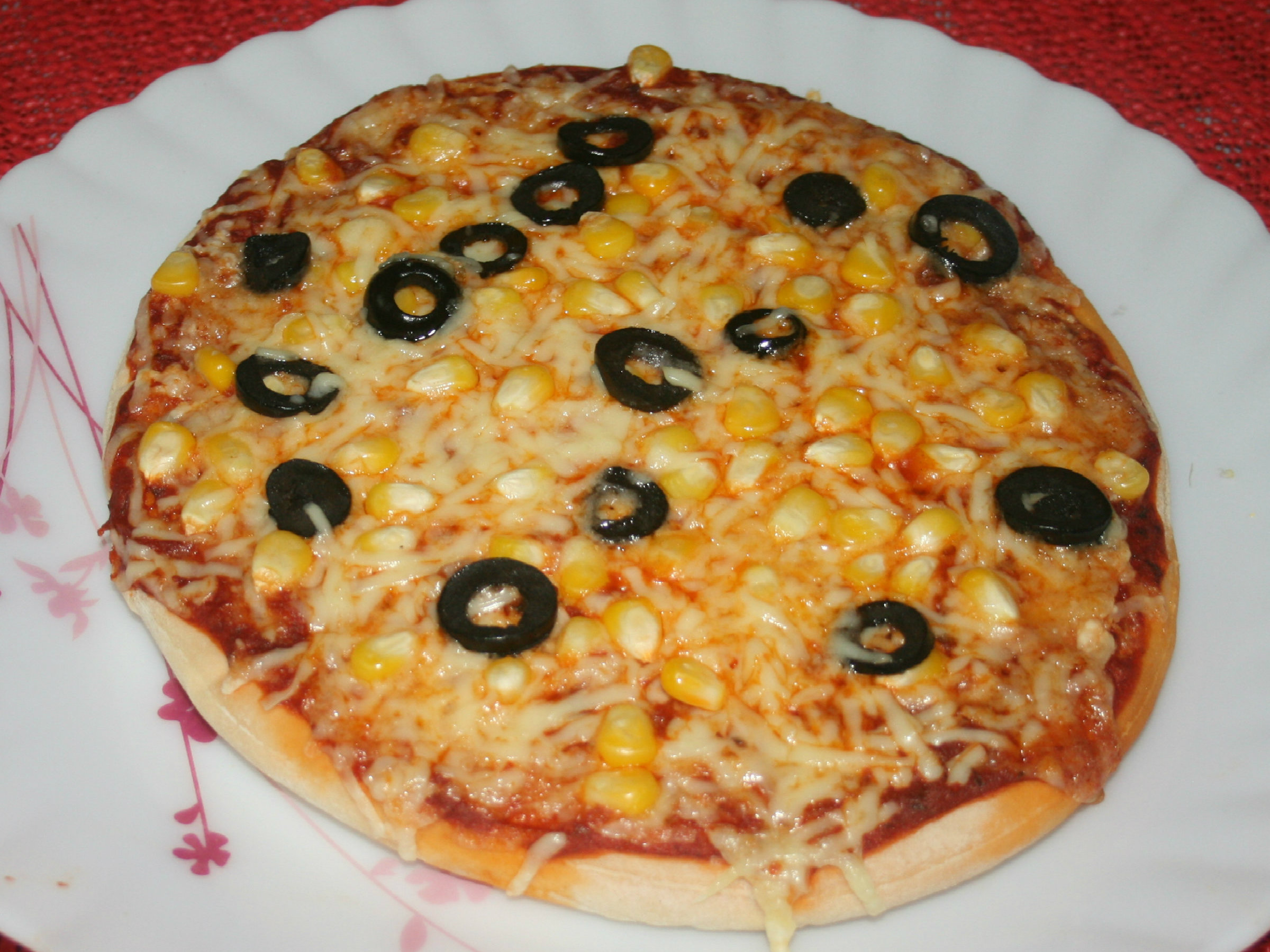 corn and olive pizza recipe by roli. Black Bedroom Furniture Sets. Home Design Ideas