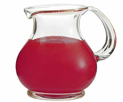 Clear and healthy cranberry juice poured in a glass jar