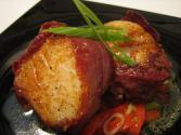 Diver Scallops Wrapped In Jamn Over Piquillo Pepper Salad