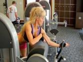 Women Biceps Workout In The Gym