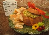 Holiday Artichoke Sweet Onion And Cheese Dip In A Bread Basket