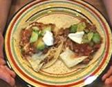 Huevos Rancheros With Refried Beans And Fried Eggs