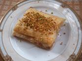 Mutabbak (buttery Phyllo Dessert With Melted Cheese, Pistachios, And Sweet Lemon Syrup)