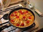 Pork With Rice  Onions  And Tomatoes