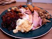 Spice Rubbed Roasted Turkey With Fruit And Nut Stuffing