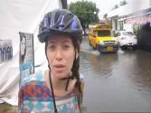 Riding Our Bicycles Down The Street During A Flash Flood In Chiang Mai, Thailand