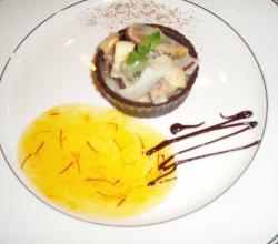 Panchamrit In Chocolate Cups With Apricot Saffron Sauce