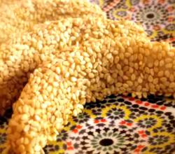 "Gazelle Horns Covered with Sesame Seeds / ""Kab-El-Ghazal"": Moroccan Almond Cookies"