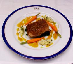 Cumin Crusted Bekti With Orange Reduction