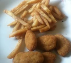 Deep fried chicken nuggets and fries
