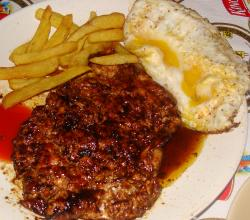 Goan Chicken Steak With Fried Eggs And Finger Chips
