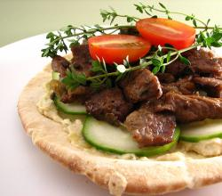 Pita Topped With Artichoke Hummus And Lamb