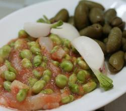 Beans with tomato, cod, radishes and olives