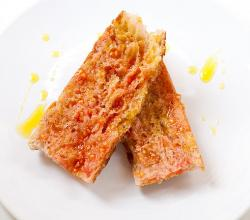 catalan bread rubbed with fresh tomato and olive oil