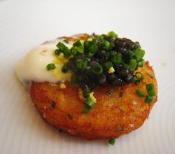 Caviar on potato cake with crème fraîche and chive