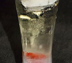 Champagne with a raspberry in a frozen glass