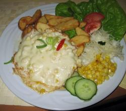 Chicken with cheese and corn, potato wedges, garnish